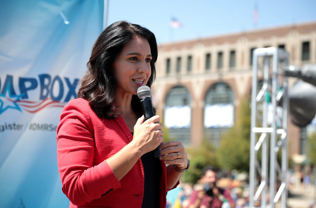 Gabbard calls on Biden, Sanders to help put her on debate stage